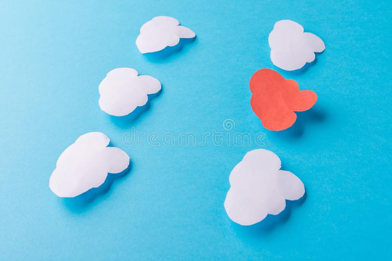 White paper clouds on blue background. Cloud computing concept royalty free stock photos