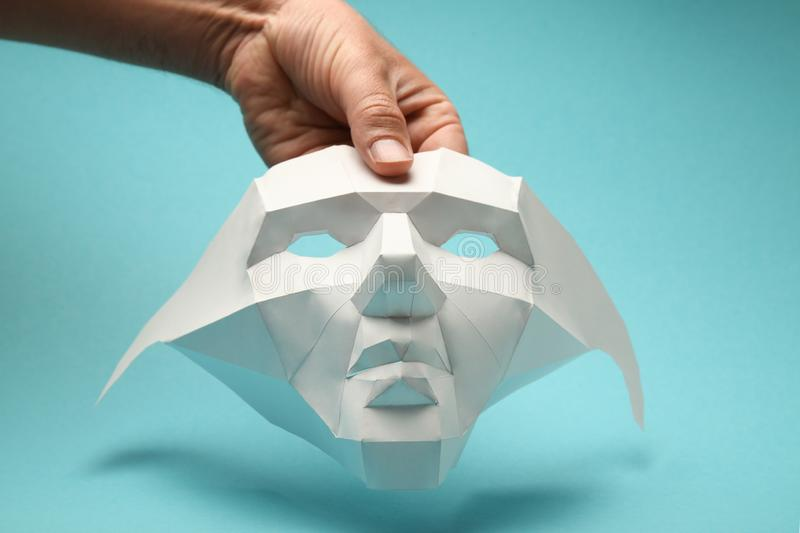 White paper face mask, concealment of personality, machine recognition of people. Social anonymity royalty free stock photo