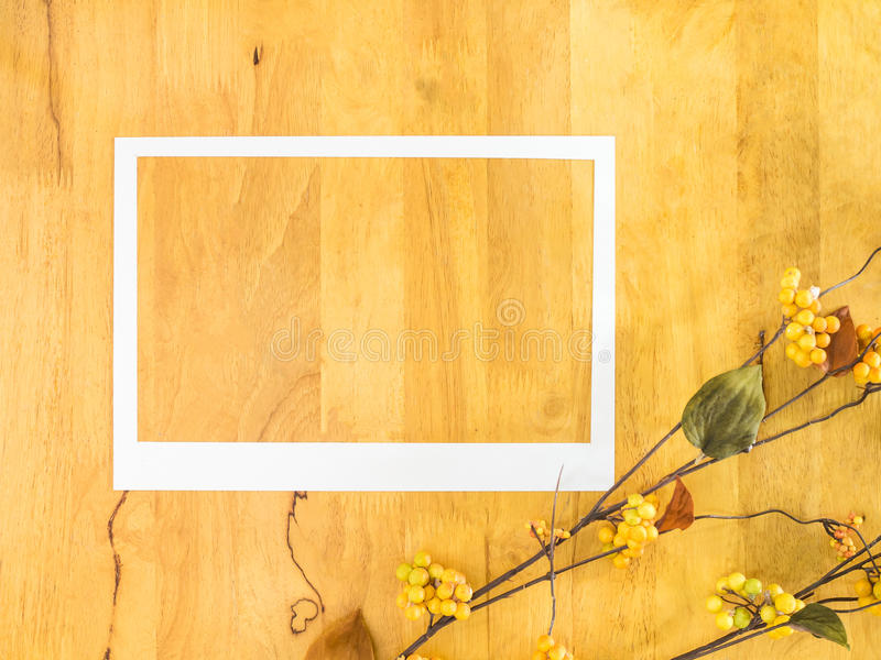 White paper frame on wood background. royalty free stock photography