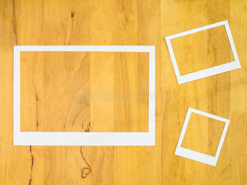 White paper frame on wood background. stock photo