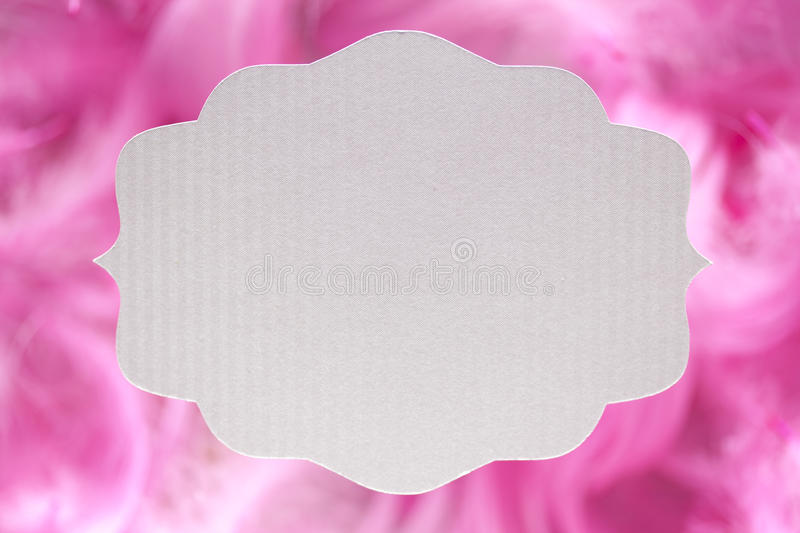 White paper label on pink background royalty free stock photography