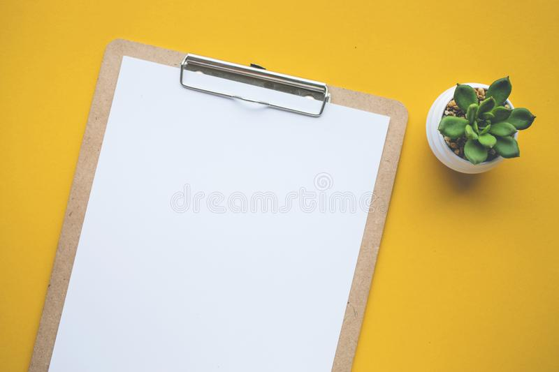 White paper notepad on pastel color backgrounds.Flat lay design. royalty free stock photos