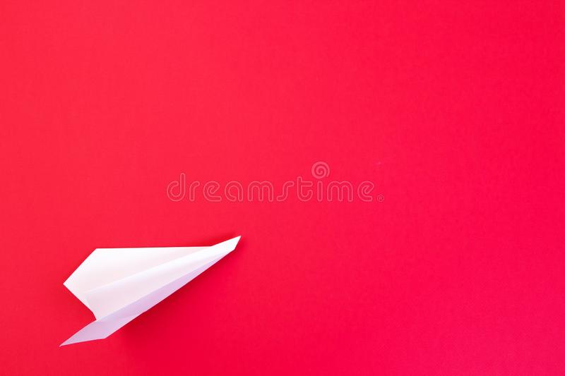 White paper origami airplane stock photography