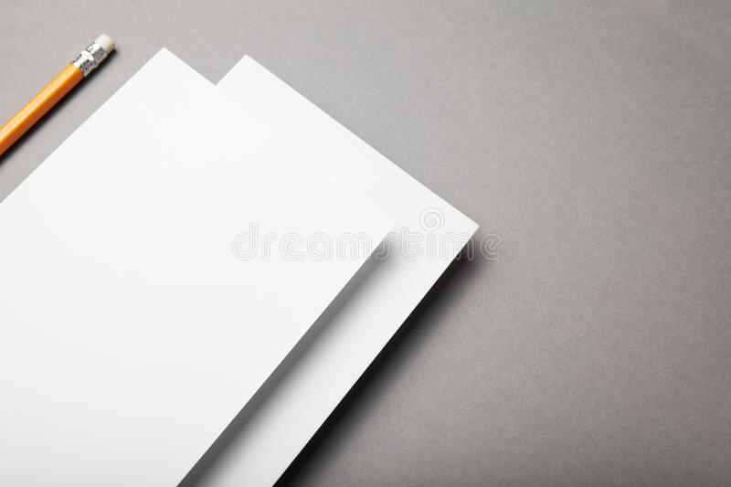 White paper and pencil on a gray background royalty free stock photography