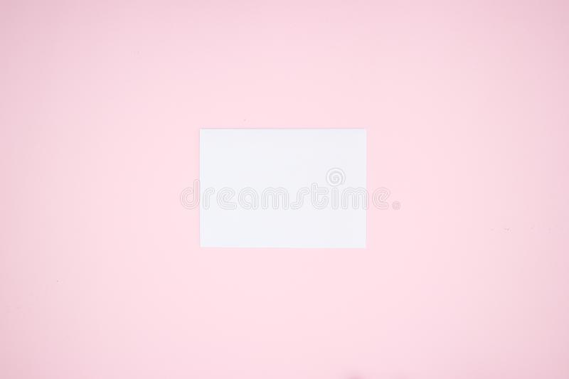 White paper on the pink background stock photo