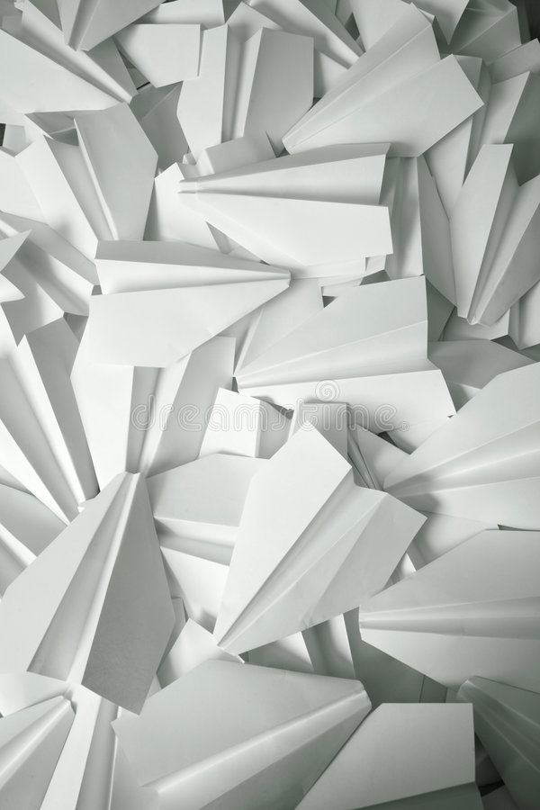 White paper planes stock photography
