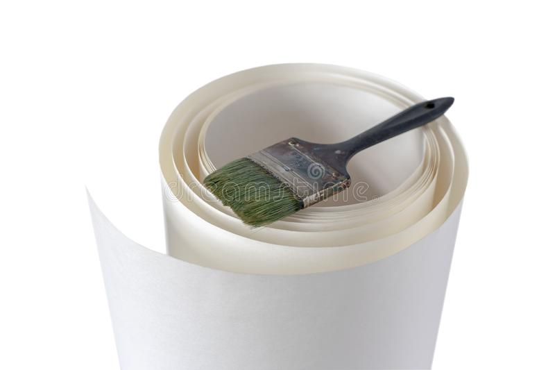 White paper roll and work paint brush royalty free stock images