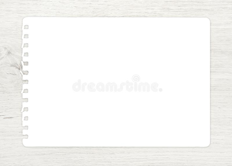 White paper sheet on wood for background stock photo