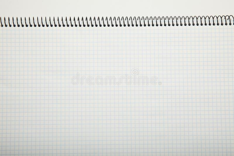 White paper texture in a cage, abstract. Notepad background stock photo