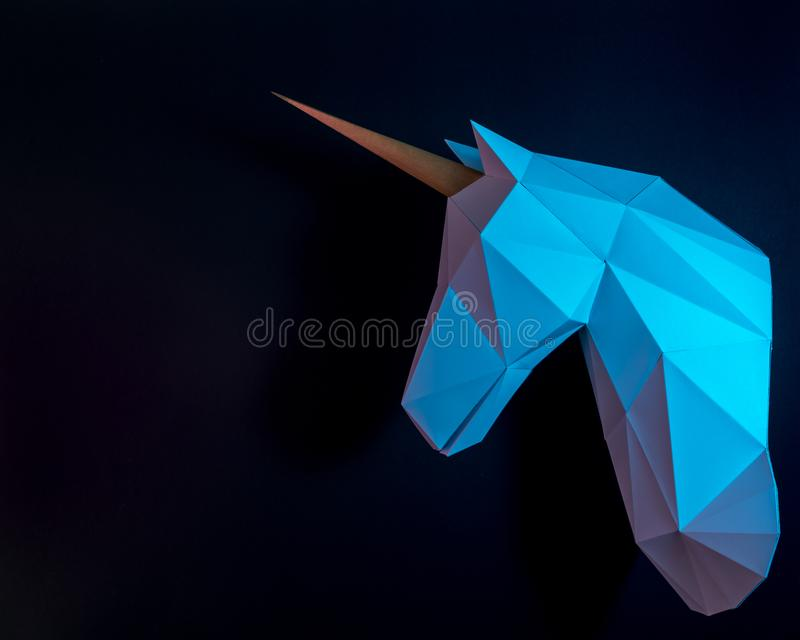White paper unicorn head in vibrant bold gradient holographic colors. Minimal art fantasy concept.  royalty free stock photography