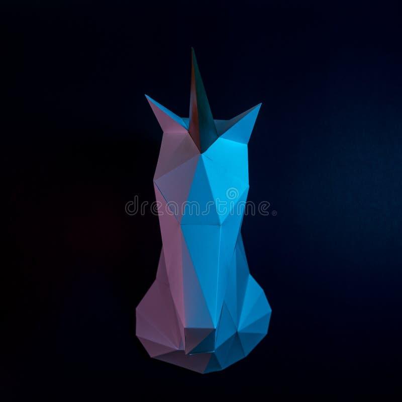 White paper unicorn head in vibrant bold gradient holographic colors. Minimal art fantasy concept.  royalty free stock photo