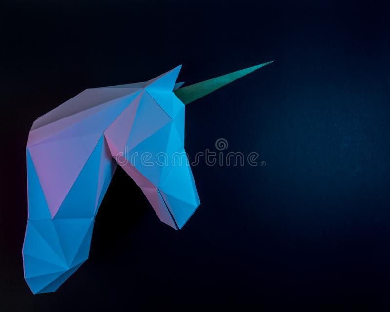 White paper unicorn head in vibrant bold gradient holographic colors. Minimal art fantasy concept.  royalty free stock image