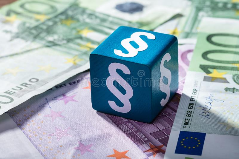 Paragraph Symbol On Blue Block Over The Euro Notes stock photo