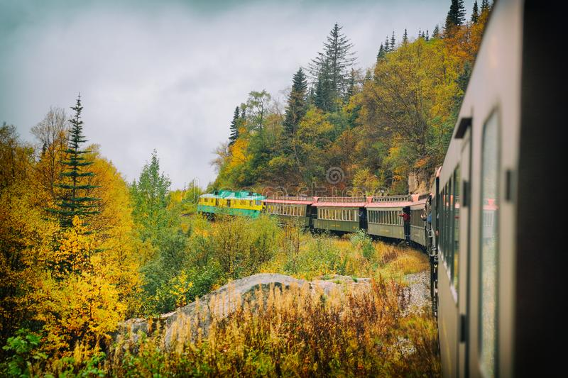 White Pass and Yukon route railroad train ride on old transport rails in Alaska, USA. Nature landscape of Alaska travel cruise royalty free stock photos