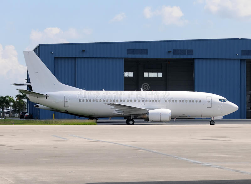 White passenger jet royalty free stock photos