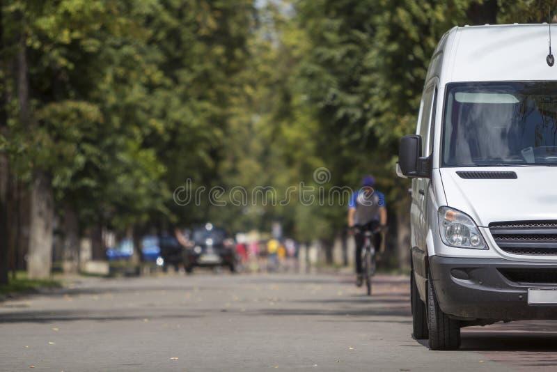 White passenger medium size commercial German luxury minibus. stock photography