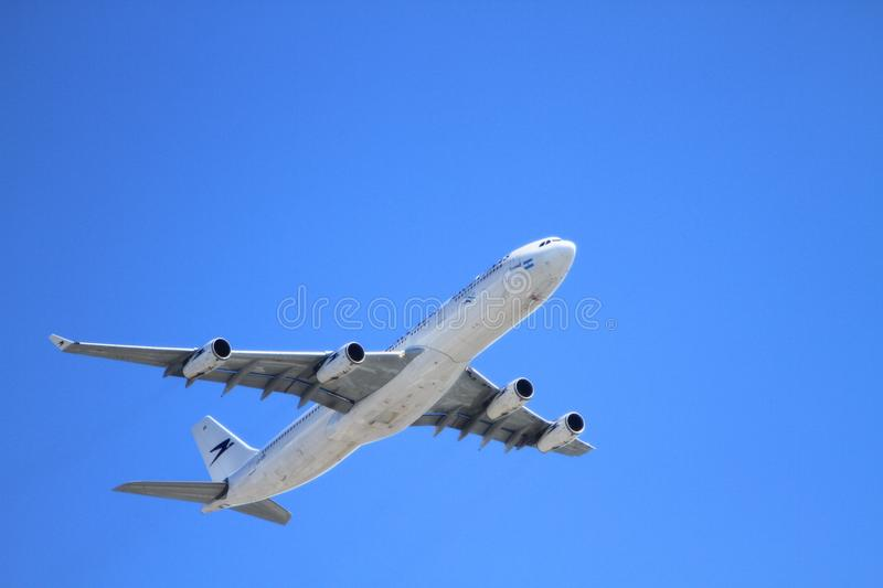 White Passenger Plane Flying on Sky during Day Time royalty free stock image