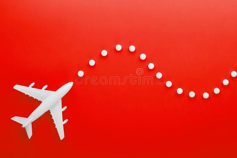 White passenger plane with trajectory points, as on a route map, isolated with a red background stock image