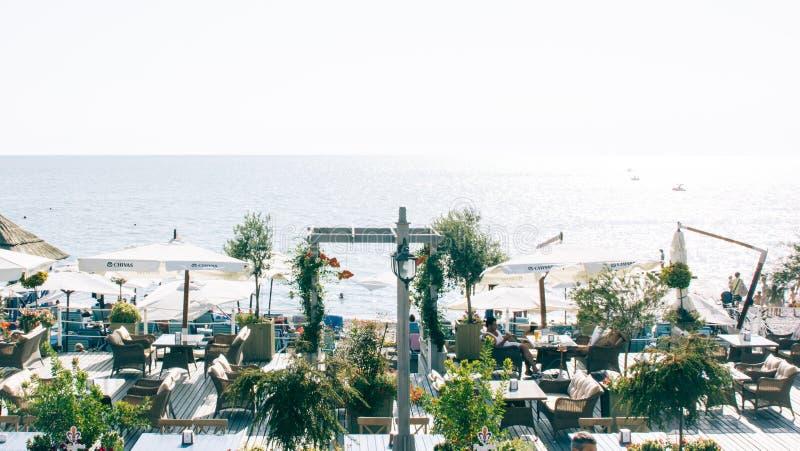 White Patio Table Set Near Ocean royalty free stock photos