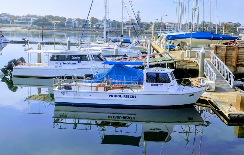 White Patrol-rescue Boat Near Brown Wooden Sea Dock stock photos