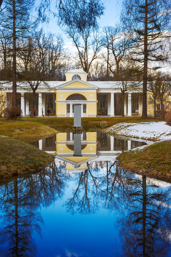White pavilion and lake in the park of Pavlovsk on the spring sunny day. St. Petersburg. Russia stock images