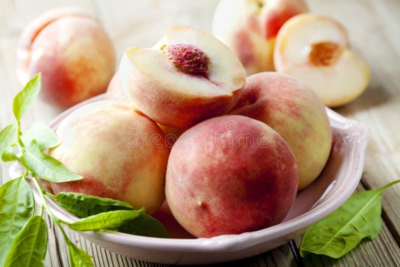 White peaches stock images