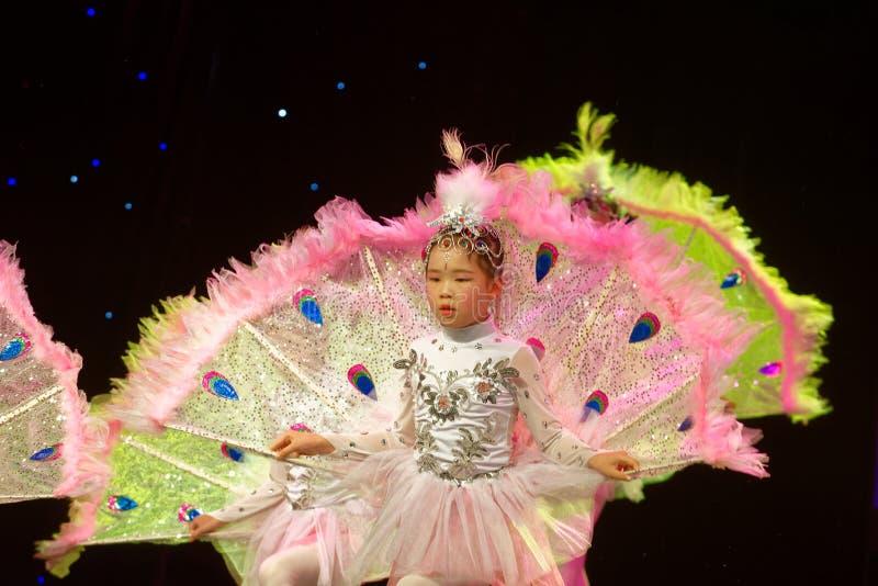 White Peacock- Beijing Dance Academy grading test outstanding children`s dance teaching achievement exhibition Jiangxi. Sponsored by the Beijing Dance Academy stock photo
