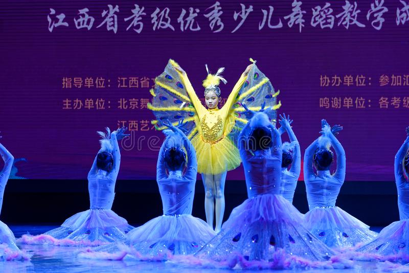 White Peacock- Beijing Dance Academy grading test outstanding children`s dance teaching achievement exhibition Jiangxi. Sponsored by the Beijing Dance Academy stock photography