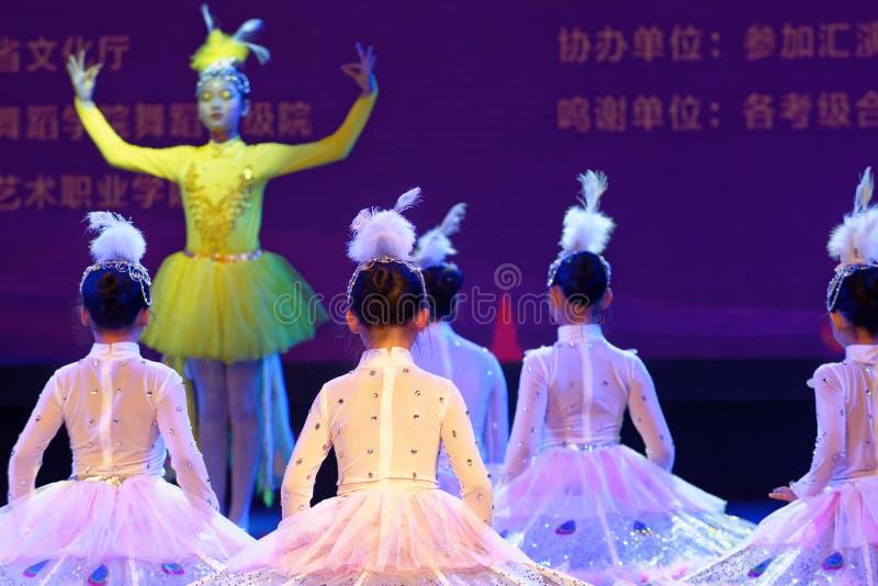 White Peacock- Beijing Dance Academy grading test outstanding children`s dance teaching achievement exhibition Jiangxi. Sponsored by the Beijing Dance Academy royalty free stock photo