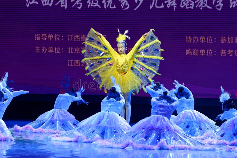 White Peacock- Beijing Dance Academy grading test outstanding children`s dance teaching achievement exhibition Jiangxi. Sponsored by the Beijing Dance Academy royalty free stock photos