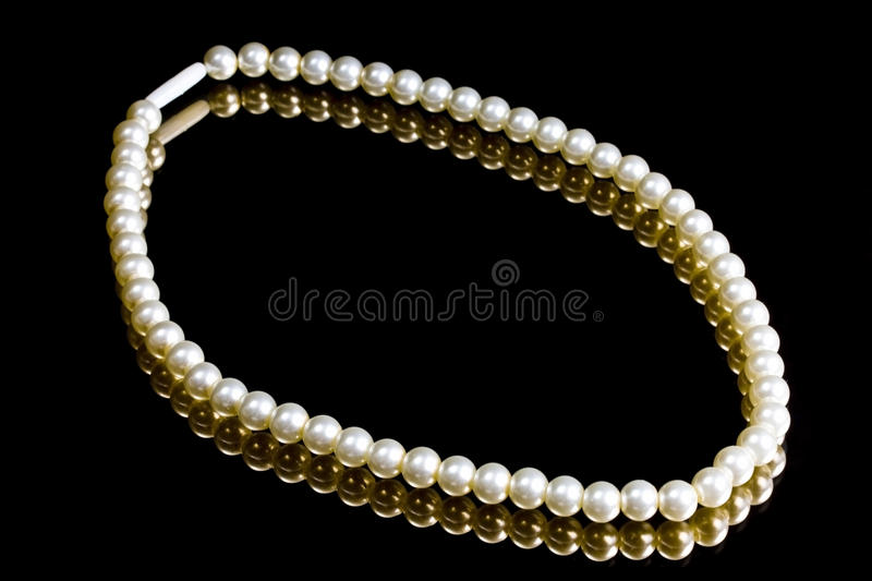 White Pearl Necklace. On black stock image