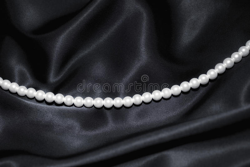 Download White Pearl Necklace On Black Silk Stock Images - Image: 14885994
