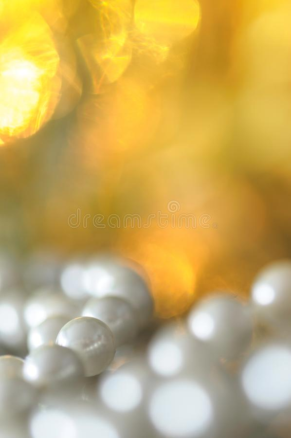 White pearl necklace, bokeh background. White pearl necklace. Selective focus and shallow depth of field royalty free stock photos