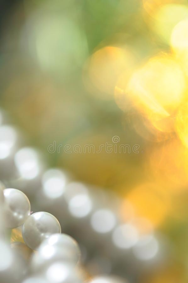 White pearl necklace, bokeh background. White pearl necklace. Selective focus and shallow depth of field stock images