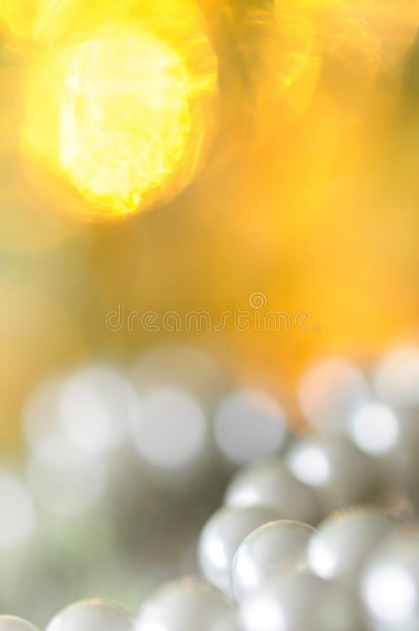 White pearl necklace, bokeh background. White pearl necklace. Selective focus and shallow depth of field stock photos