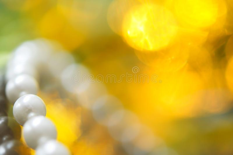 White pearl necklace, bokeh background. White pearl necklace. Selective focus and shallow depth of field royalty free stock images