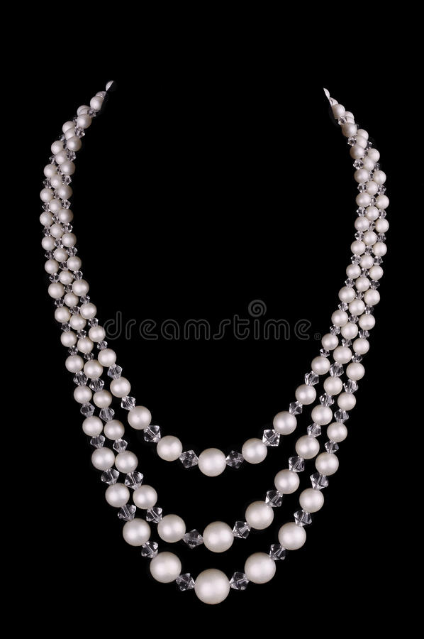 White pearls luxury necklace on black background royalty free stock photos
