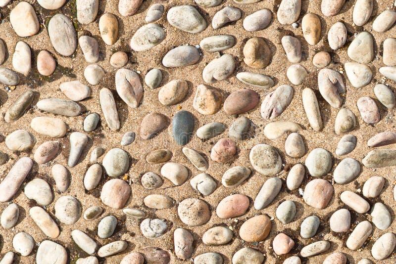 White pebble stones on concrete texture seamless endless pattern stock images