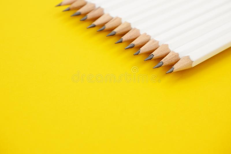 White pencils on vivid yellow background. White pencils on vivid yellow background with copy space. Feminine styled stock photography for blog posts and social royalty free stock image
