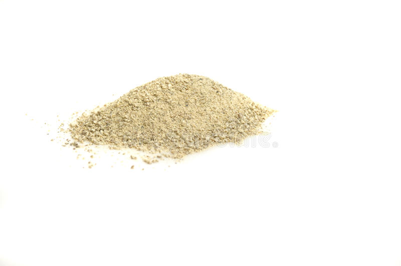 White pepper powder. Close-up on white pepper powder, isolated on white royalty free stock photography