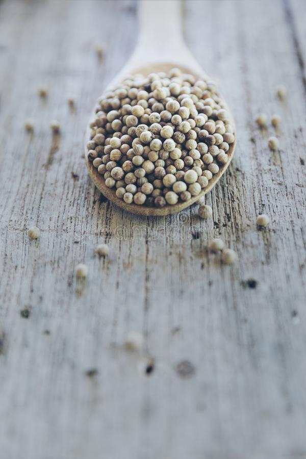 White pepper on wood table. royalty free stock image