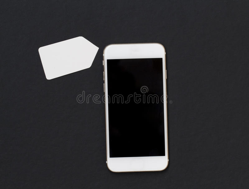 White phone with blank price label on black background. Smartphone with black screen banner template. stock image