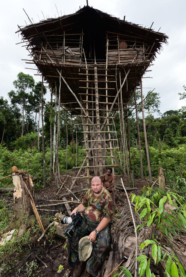Download White Photographer At Korowai People House Editorial Stock Image - Image of natural, asia: 27561269