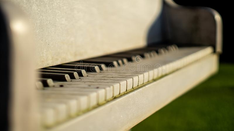 White piano made of marble stone close up. White piano keys made of marble stone close up view with depth of field stock images