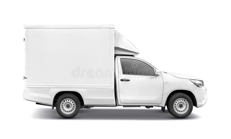 White pick-up truck with container box roof rack for tranportation stock image