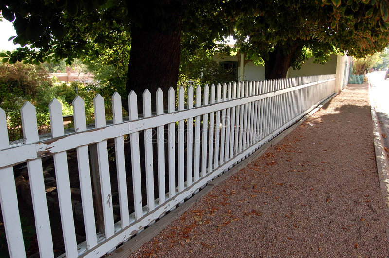White Picket Fence. Bordering a historical home in Santa Fe, New Mexico royalty free stock photo