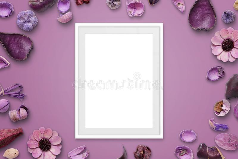 White picture frame on pink background surrounded with flower decorations stock photos