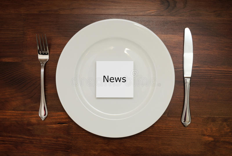 White piece of paper with a word NEWS on a plate. Mockup royalty free stock photos