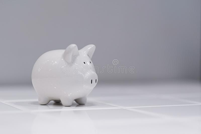 White piggy bank on the white background. Business, investment, money, concept, banking, finance, financial, economy, save, cash, deposit, toy, retirement stock photos