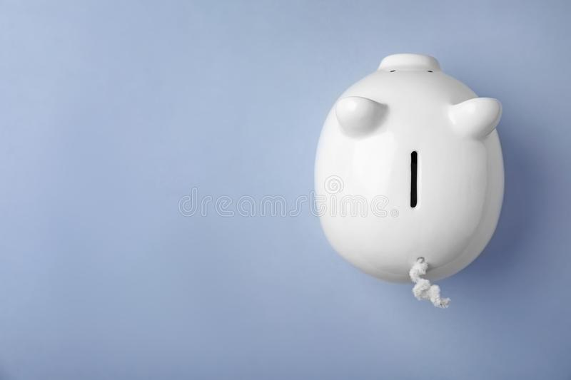 White piggy bank on color background,. Top view royalty free stock photo